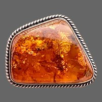 Exceptionally Radiant Antique Baltic Amber Brooch in Roped Sterling