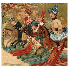 French, Victorian, gilded Au Bon Marché collectible trade card of children racing hobby-horses