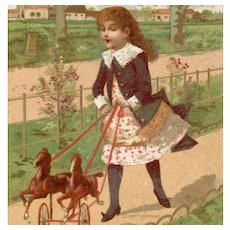 French Au Bon Marché Paris gilded trade card of child with horse toy