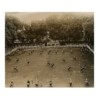 Antique postcard of dressage horses and riders doing airs above the ground