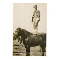 Unposted, real photo postcard of soldier and horse