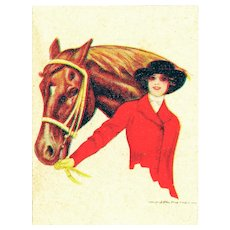 Unused, Italian, gilded, artist signed Nanni postcard of a glamour woman holding her horse