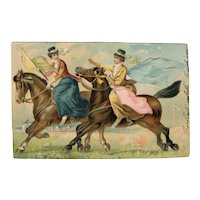 Undivided back postcard of two women riding sidesaddle and carrying flags posted 1902