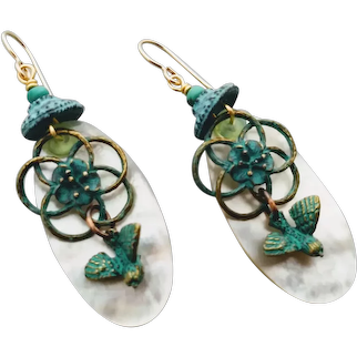 Bird and flower in brass with a patina on mother of pearl earrings light weight