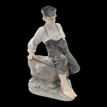 Royal Copenhagen Figurine - Porcelain Shepherd Boy on Rock - #1659