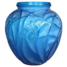 A blue electric Criquet vase , created by R.Lalique in 1912.