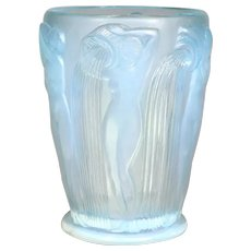 A Danaides vase by R. .Lalique in opalescent glass.