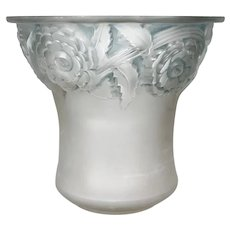 An Orléans vase  in transparent and patinated  blue glass , created by R.Lalique in 1930.