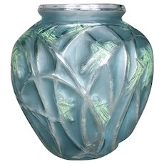 A Criquet vase in white  and patinated glass  created by R.Lalique in 1912.