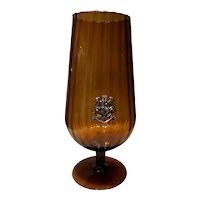 Glass cup with a metal shield encrusted. 20th century