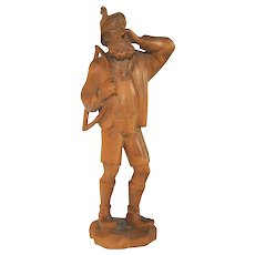 Vintage Swiss Woodcarving of Man Yodeling, Carrying Saw