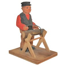 Vintage Folk Art Swedish Wooden Carving of Man Sawing Log