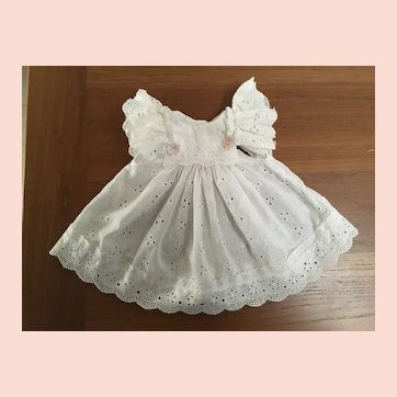 """Pinafore of white eyelet fabric for approximately 18"""" doll."""