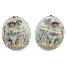 Charming Hand Painted Porcelain Bisque Pair of Wall Plaques