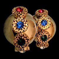1960s 4 color rhinestones earrings On large goldtone dome clip-on