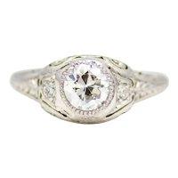 Sumptuously Engraved Art Deco Diamond Engagement Ring in Platinum