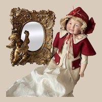 Rare Venetian mirror with gilded wooden frame and carved with a cherubin with a musical instrument