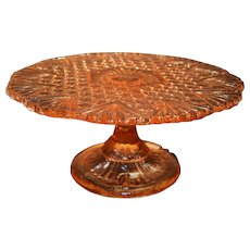 """Pink """"geuridon"""" cake stand in pressed glass."""