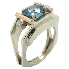 Blue Zircon Oval and Diamond in White and Rose 18K Gold Ring