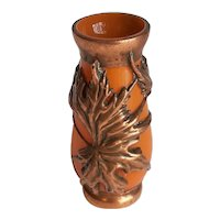 Glass vase with copper