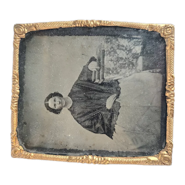Foil Tintype Woman resting on books
