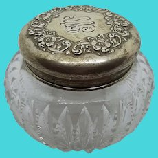 Sterling topped dressing jar.