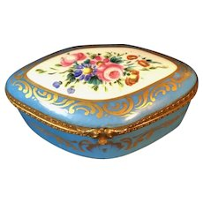 Vintage French Limoges Blue and Gold Box decorated with a Spray of Flowers against White Background