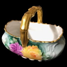 Limoges France Hand-Painted Porcelain Basket with Purple and Yellow Chrysanthemums and Gold around the rim and on the handle.