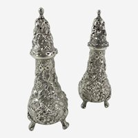 Pair Stieff repousse sterling shakers