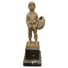 Bronze Figure of a Young Boy Smoking Circa 1920