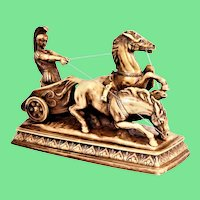 Gladiator in a Roman chariot, vintage sculpture.