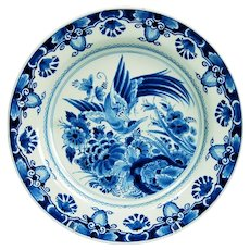 Chinoiserie from Dutch Delft faïence from the 20th century in a cobalt blue charger