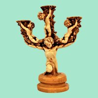 Shabby Chic candlestick with an elaborate design by cherubs