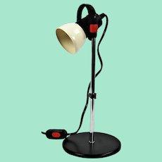 Vintage adjustable industrial desk lamp.