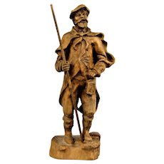 The statue of the village guard, a hand-carved wooden sculpture