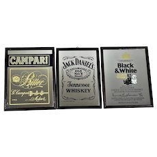 Three vintage advertising mirrors Campari, Jack Daniels, Black & White Vintage.