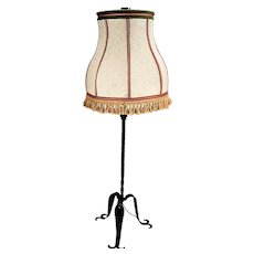 Attractive, decorated and unique wrought iron floor lamp.