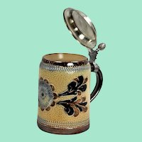 Vintage ceramic beer mug with tin lid