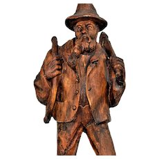 Wooden carved statuette.