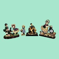 Four vintage figurines. Decorative and beautifully detailed.