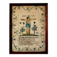 Historic 1831 English sampler with an image of Christ crucified