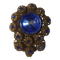 Brass and faceted blue glass fur or dress clip