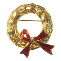 Gold tone wreath brooch with red enamel bow