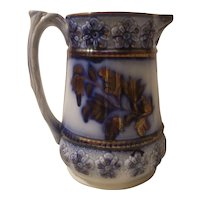 Flow blue and copper luster pitcher marked Charles Allerton and sons