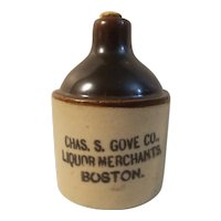 Liquor advertising stoneware mini jug