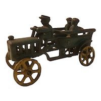 Early cast iron toy auto with driver and 2 passengers