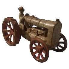 Toy cast iron tractor