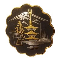 Black, gold and silver colored Japanese influenced brooch