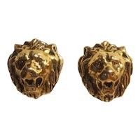 Gold tone lion head clip on earrings