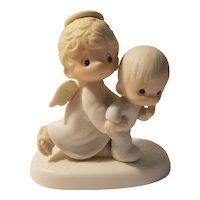 Precious Moments 'Baby's first step' figurine